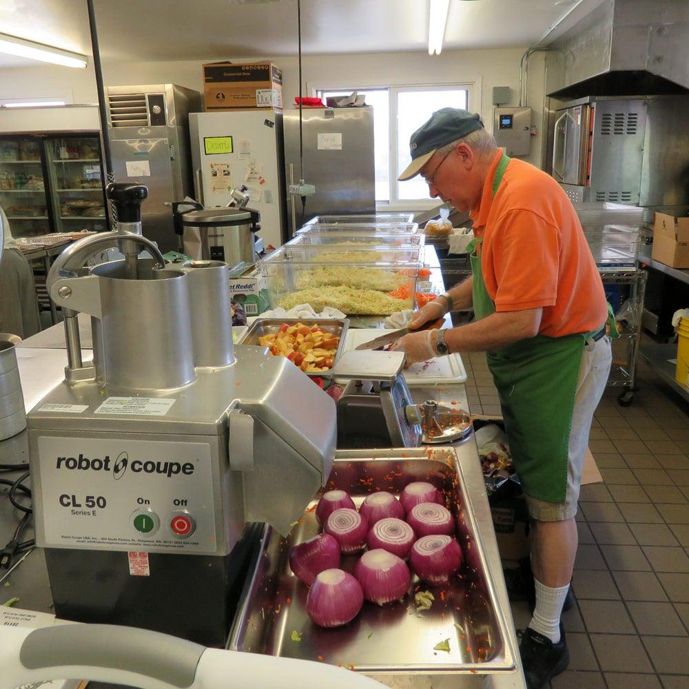 The Kraut Guy in kitchen preparing sauerkraut